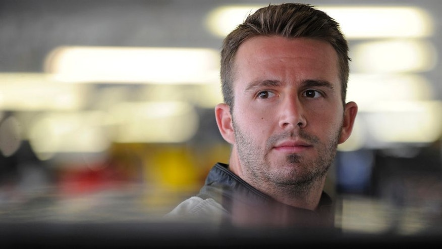 KANSAS CITY, KS - MAY 06: Matt DiBenedetto, driver of the #83 Cosmo Motors Toyota, looks on during practice for the NASCAR Sprint Cup Series Go Bowling 400 at Kansas Speedway on May 6, 2016 in Kansas City, Kansas. (Photo by Ed Zurga/Getty Images)