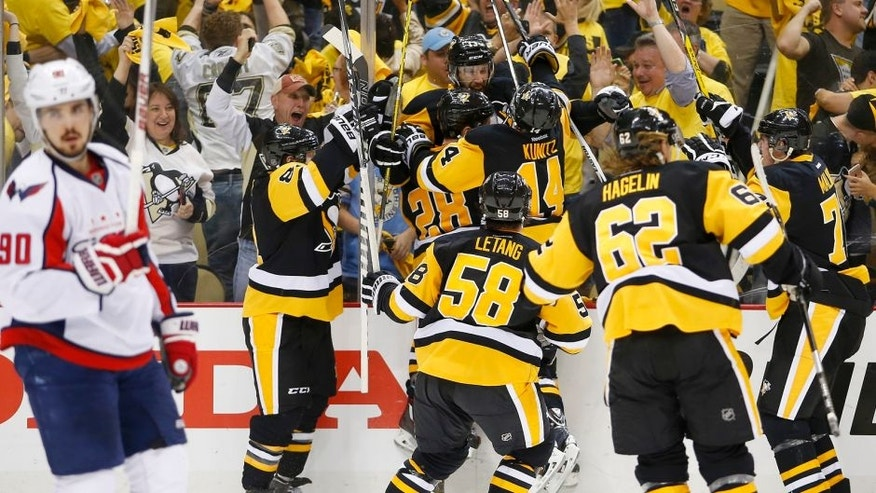 PITTSBURGH, PA - MAY 10: Nick Bonino #13 of the Pittsburgh Penguins celebrates his game winning overtime goal against the Washington Capitals in Game Six of the Eastern Conference Second Round during the 2016 NHL Stanley Cup Playoffs at Consol Energy Center on May 10, 2016 in Pittsburgh, Pennsylvania. (Photo by Justin K. Aller/Getty Images)