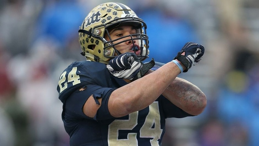 FORT WORTH, TX - JANUARY 02: James Conner #24 of the Pittsburgh Panthers celebrates after scoring a touchdown during the Lockheed Martin Armed Forces Bowl game against the Houston Cougars at Amon G. Carter Stadium on January 2, 2015 in Fort Worth, Texas. (Photo by Sarah Glenn/Getty Images)