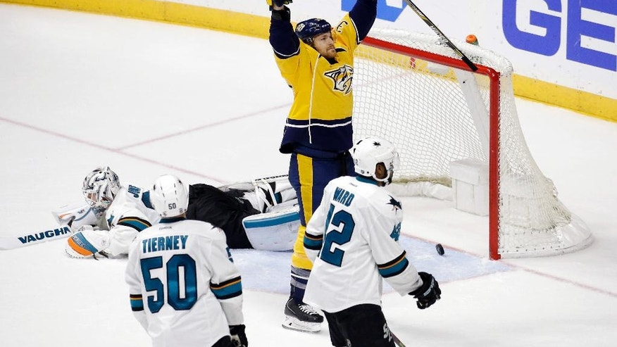 Nashville Predators center Colin Wilson (33) celebrates after scoring a goal against San Jose Sharks goalie Martin Jones, left, during the third period in Game 6 of an NHL hockey Stanley Cup Western Conference semifinal playoff series, Monday, May 9, 2016, in Nashville, Tenn. Also defending for the Sharks are Chris Tierney (50) and Joel Ward (42). (AP Photo/Mark Humphrey)