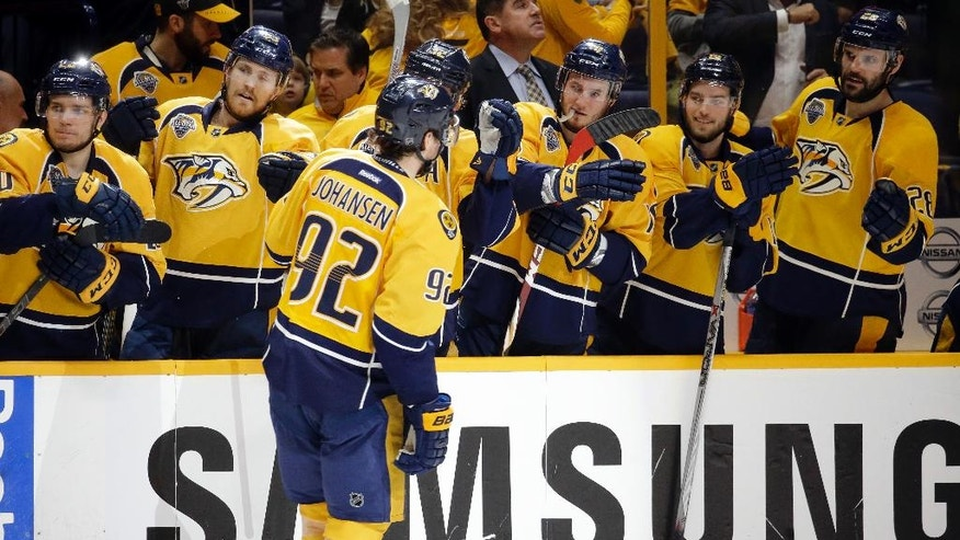 Nashville Predators center Ryan Johansen (92) is congratulated by teammates after scoring against the San Jose Sharks during the second period in Game 6 of an NHL hockey Stanley Cup Western Conference semifinal playoff series Monday, May 9, 2016, in Nashville, Tenn. (AP Photo/Mark Humphrey)