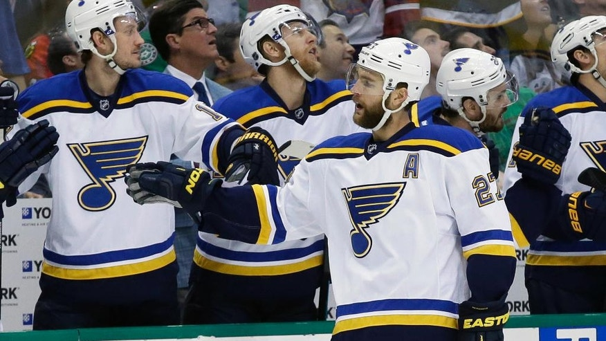 St. Louis Blues defenseman Alex Pietrangelo (27) celebrates his goal with the bench during the first period of Game 7 of the NHL hockey Stanley Cup Western Conference semifinals against the Dallas Stars Wednesday, May 11, 2016, in Dallas. (AP Photo/LM Otero)