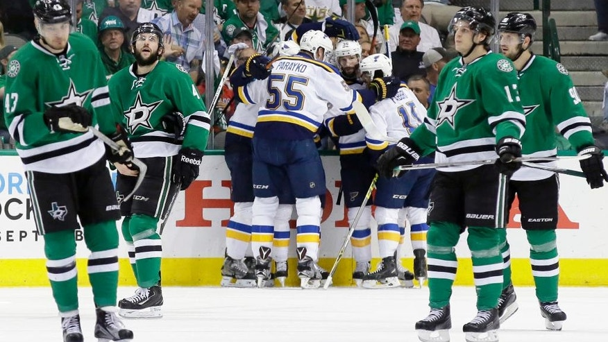 St. Louis Blues center Paul Stastny, center left obscured, celebrates his goal with teammates Robby Fabbri (15), Colton Parayko (55) and Troy Brouwer (36) as Dallas Stars Valeri Nichushkin (43), Jason Demers (4), Mattias Janmark (13) and Jason Spezza (90) skate away during the first period of Game 7 of the NHL hockey Stanley Cup Western Conference semifinals Wednesday, May 11, 2016, in Dallas. (AP Photo/LM Otero)