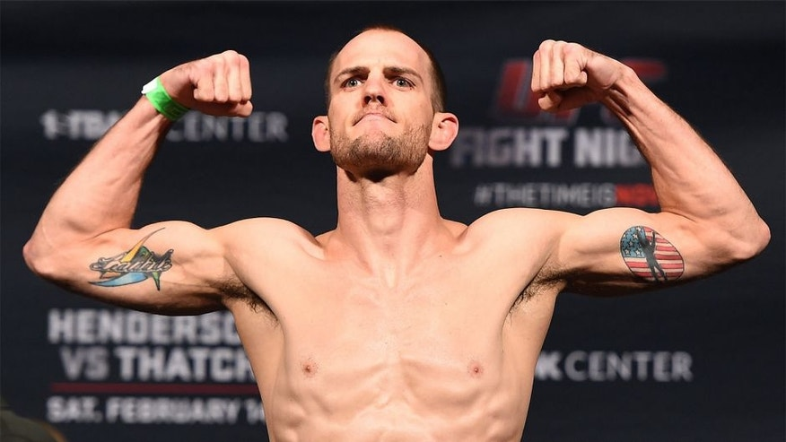 BROOMFIELD, CO - FEBRUARY 13: Cole Miller weighs in during the UFC weigh-in at the 1stBank Center on February 13, 2015 in Broomfield, Colorado. (Photo by Josh Hedges/Zuffa LLC/Zuffa LLC via Getty Images)