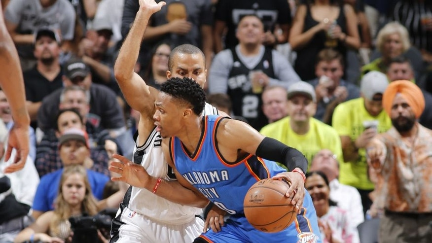 <p>SAN ANTONIO, TX - MAY 10: Russell Westbrook #0 of the Oklahoma City Thunder handles the ball against the San Antonio Spurs in Game Five of the Western Conference Semifinals during the 2016 NBA Playoffs on May 10, 2016 at the AT&T Center in San Antonio, Texas. NOTE TO USER: User expressly acknowledges and agrees that, by downloading and or using this photograph, user is consenting to the terms and conditions of the Getty Images License Agreement. Mandatory Copyright Notice: Copyright 2016 NBAE (Photos by Chris Covatta/NBAE via Getty Images)</p>