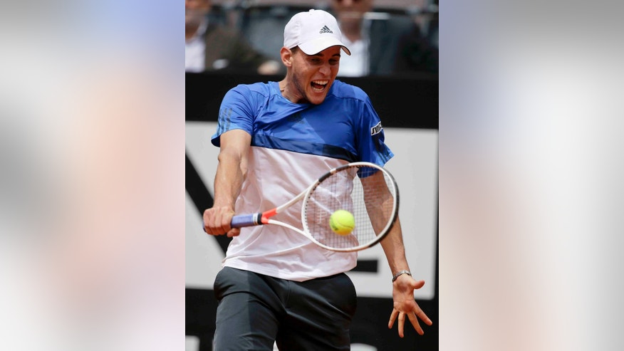 Dominic Thiem of Austria returns the ball to Roger Federer of Switzerland during their match at the Italian Open tennis tournament, in Rome, Thursday, May 12, 2016. (AP Photo/Andrew Medichini)