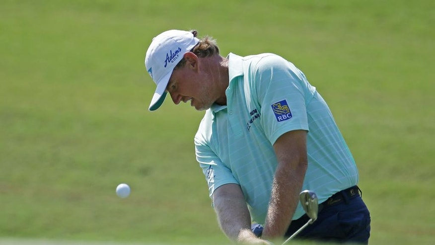Ernie Els, of South Africa, hits from the third green during the first round of The Players Championship golf tournament Thursday, May 12, 2016, in Ponte Vedra Beach, Fla. (AP Photo/ Lynne Sladky)