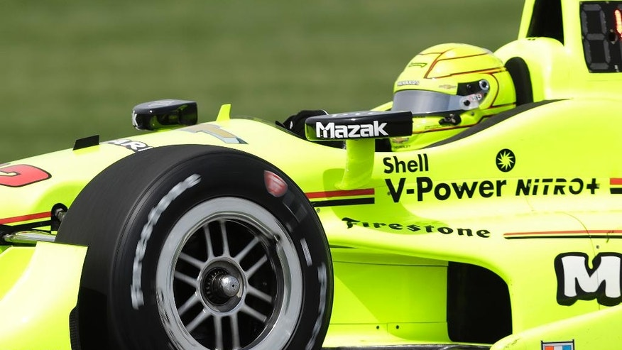 Simon Pagenaud, of France, steers his car during practice session for the Grand Prix of Indianapolis auto race at Indianapolis Motor Speedway in Indianapolis, Thursday, May 12, 2016. (AP Photo/Darron Cummings)