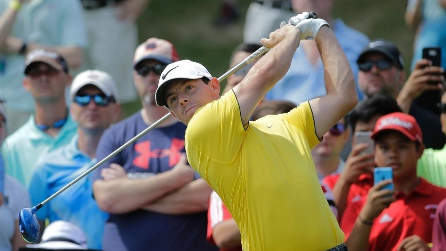 Rory McIlroy, of Northern Ireland, tees off on the 16th hole during a practice round for The Players Championship golf tournament Wednesday, May 11, 2016, in Ponte Vedra Beach, Fla. (AP Photo/Chris O'Meara)