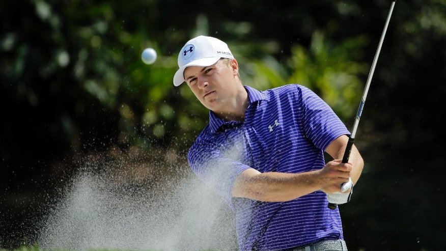 Jordan Spieth hits from the sand trap on the 14th hole during a practice round for The Players Championship golf tournament Wednesday, May 11, 2016, in Ponte Vedra Beach, Fla. (AP Photo/Chris O'Meara)