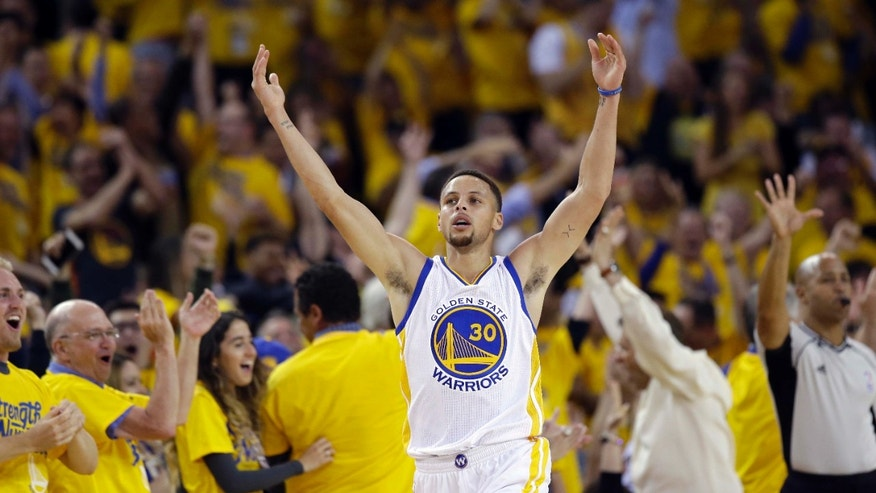 Golden State Warriors' Stephen Curry celebrates after scoring against the Portland Trail Blazers during the first half in Game 5 of a second-round NBA basketball playoff series Wednesday, May 11, 2016, in Oakland, Calif.