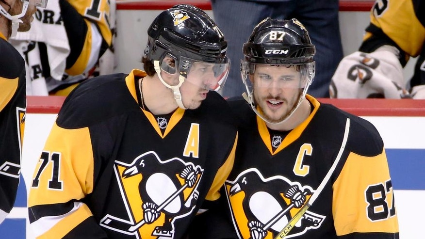 Pittsburgh Penguins' Sidney Crosby (87) and Evgeni Malkin talk as they return to the ice after a stop in play during the third period of Game 6 of the NHL hockey Stanley Cup Eastern Conference semifinals against the Washington Capitals], Tuesday, May 10, 2016 in Pittsburgh. (AP Photo/Gene J. Puskar)