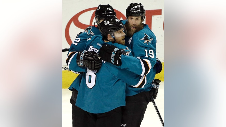 San Jose Sharks' Joe Pavelski, left, celebrates with Joe Thornton (19) and another teammate after scoring a goal against the Nashville Predators during the first period of Game 7 of an NHL hockey Stanley Cup Western Conference semifinal playoff series Thursday, May 12, 2016, in San Jose, Calif. (AP Photo/Ben Margot)