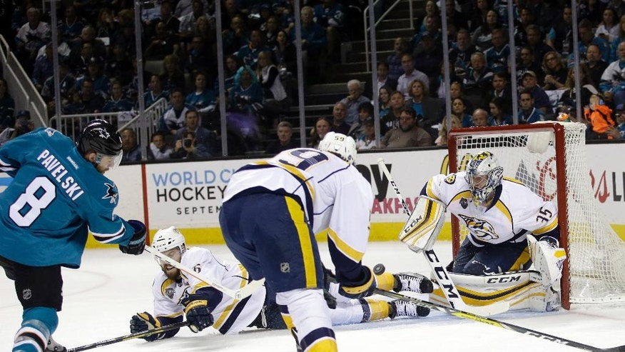 San Jose Sharks' Joe Pavelski (8) scores past Nashville Predators goalie Pekka Rinne, right, during the first period of Game 7 in an NHL hockey Stanley Cup Western Conference semifinal series Thursday, May 12, 2016, in San Jose, Calif. (AP Photo/Marcio Jose Sanchez)