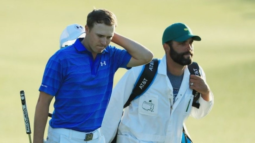 AUGUSTA, GA - APRIL 10: Jordan Spieth waits with his caddie Michael Greller on the 11th hole during the final round of the 2016 Masters Tournament at the Augusta National Golf Club on April 10, 2016 in Augusta, Georgia. (Photo by Scott Halleran/Getty Images for Golfweek) *** Local Caption *** Jordan Spieth