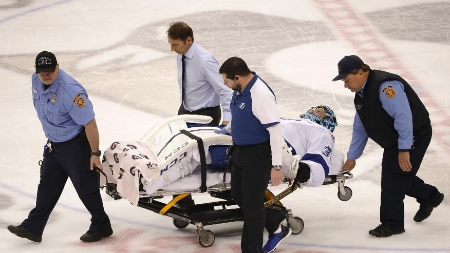 Tampa Bay Lightning goalie Ben Bishop (30) is carted off the ice after being injured during the first period of Game 1 against the Pittsburgh Penguins in the NHL hockey Stanley Cup Eastern Conference finals Friday, May 13, 2016, in Pittsburgh. (AP Photo/Gene J. Puskar)