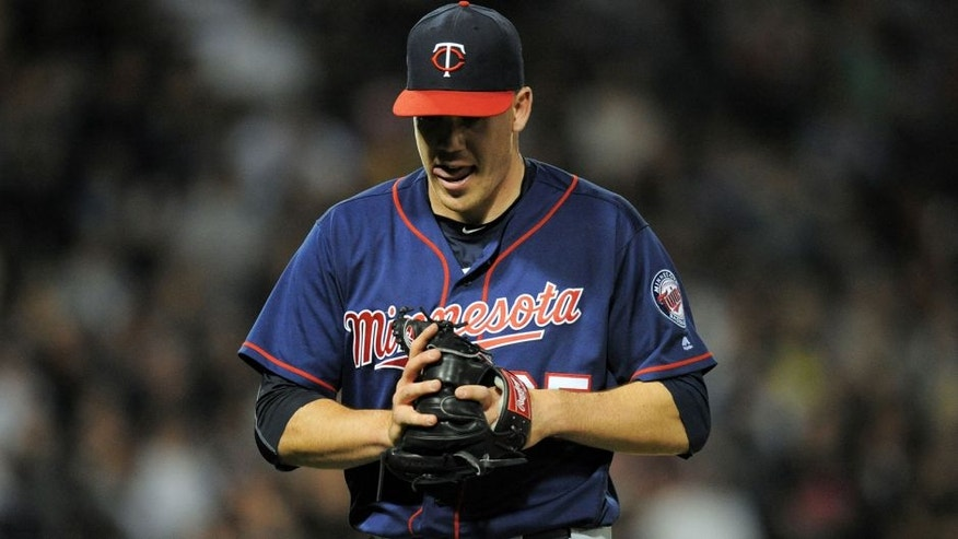 <p>May 6, 2016; Chicago, IL, USA; Minnesota Twins relief pitcher Trevor May (65) walks off the field after ending the eighth inning against the Chicago White Sox at U.S. Cellular Field. The White Sox won 10-4. Mandatory Credit: Patrick Gorski-USA TODAY Sports</p>