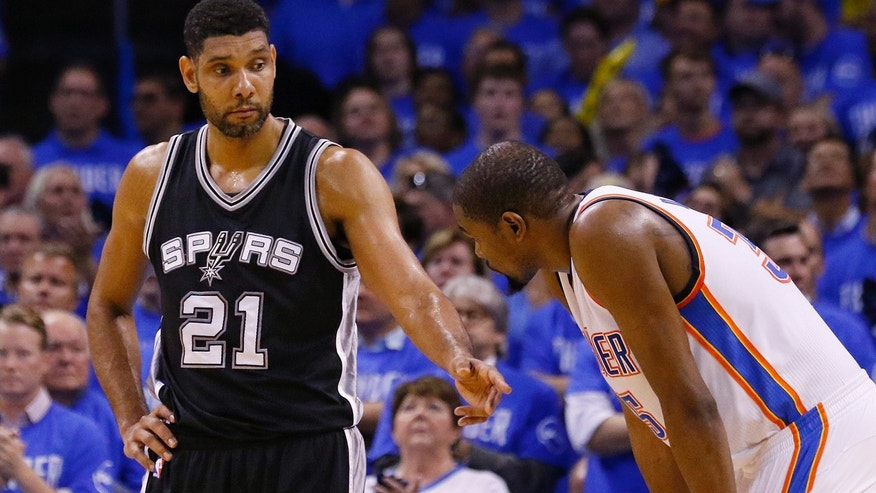 May 12, 2016: San Antonio Spurs center Tim Duncan (21) talks with Oklahoma City Thunder forward Kevin Durant, right, during the fourth quarter of Game 6 of a second-round NBA playoff series in Oklahoma City.