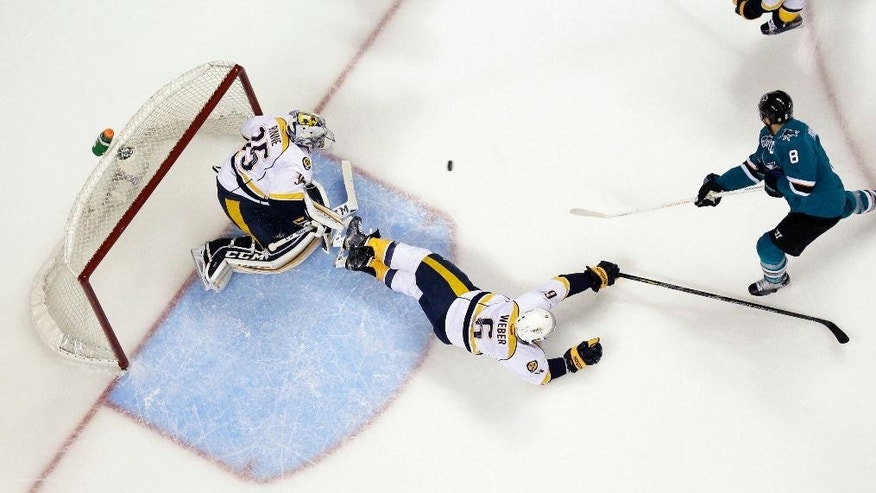May 12, 2016: San Jose Sharks forward Joe Pavelski (8) scores past Nashville Predators defenseman Shea Weber (6) and goalie Pekka Rinne during the first period of Game 7 in an NHL Western Conference semifinal series in San Jose, Calif.