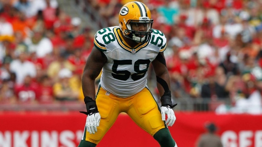 <p>Dec 21, 2014; Tampa, FL, USA; Green Bay Packers inside linebacker Sam Barrington (58) in zone coverage against the Tampa Bay Buccaneers during the first half at Raymond James Stadium. Mandatory Credit: Kim Klement-USA TODAY Sports</p>