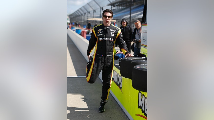 Simon Pagenaud, of France, stretches before a practice session for the Grand Prix of Indianapolis auto race at Indianapolis Motor Speedway in Indianapolis, Friday, May 13, 2016. (AP Photo/Michael Conroy)