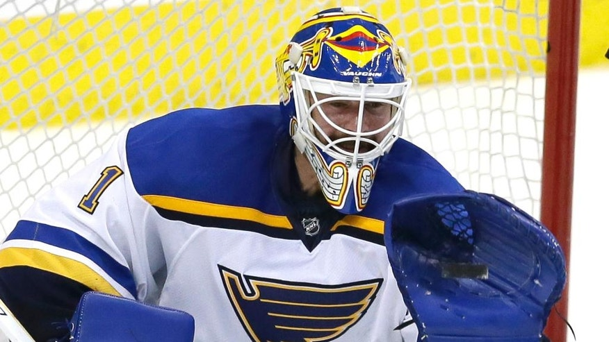 St. Louis Blues goalie Brian Elliott (1) makes a save during the third period of Game 7 of the NHL hockey Stanley Cup Western Conference semifinals against the Dallas Stars Wednesday, May 11, 2016, in Dallas. The Blues won 6-1. (AP Photo/LM Otero)