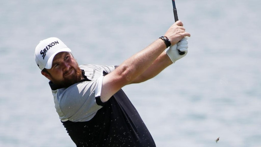 Shane Lowry,  of Ireland, watches his shot from the 18th fairway during the first round of The Players Championship golf tournament Thursday, May 12, 2016, in Ponte Vedra Beach, Fla. (AP Photo/Chris O'Meara)