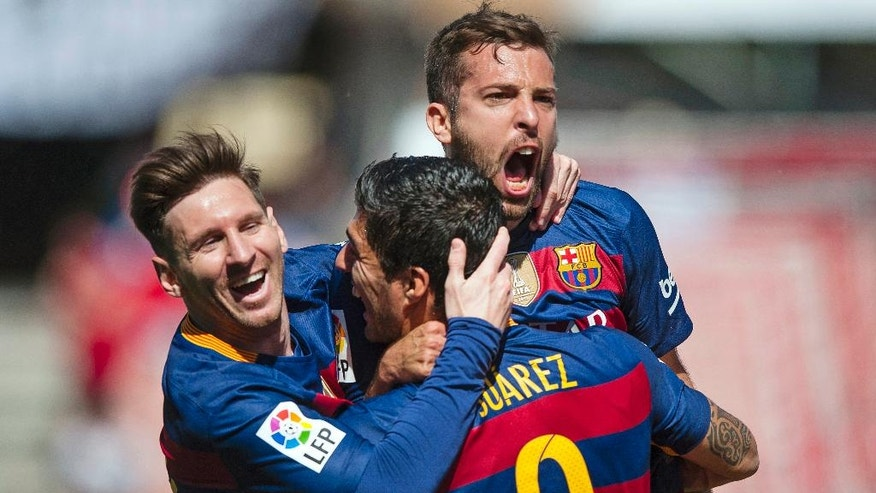 FC Barcelona's Luis Alberto Suarez from Uruguay, center, celebrates scoring against Granada with teammates Lionel Messi from Argentina, left, and Jordi Alba during a Spanish La Liga soccer match between Granada and Barcelona at Los Carmenes stadium in Granada, Spain, Saturday, May 14, 2016. (AP Photo/Daniel Tejedor)
