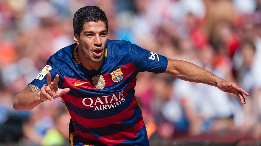 FC Barcelona's Luis Alberto Suarez from Uruguay celebrates after scoring against Granada during a Spanish La Liga soccer match between Granada and Barcelona at Los Carmenes stadium in Granada, Spain, Saturday, May 14, 2016. (AP Photo/Daniel Tejedor)