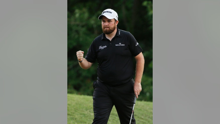 Shane Lowry, of Ireland, celebrates after making par on the eighth hole during the second round of The Players Championship golf tournament Friday, May 13, 2016, in Ponte Vedra Beach, Fla. (AP Photo/Chris O'Meara)