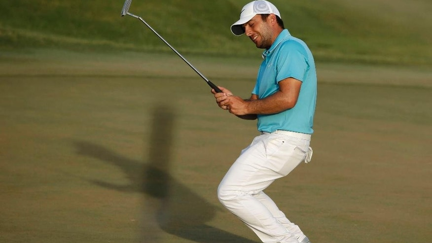 Francesco Molinari of Italy, reacts after missing par on the 18th hole during the third round of The Players Championship golf tournament Saturday, May 14, 2016, in Ponte Vedra Beach, Fla. (AP Photo/Chris O'Meara)