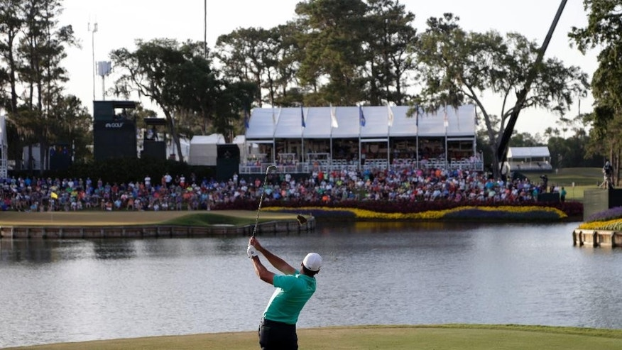 Jason Day of Australia, hits from the 17th tee during the third round of The Players Championship golf tournament Saturday, May 14, 2016, in Ponte Vedra Beach, Fla. (AP Photo/Lynne Sladky)