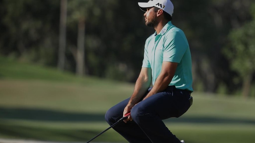 Jason Day of Australia, reacts to a missed putt on the 14th green during the third round of The Players Championship golf tournament Saturday, May 14, 2016, in Ponte Vedra Beach, Fla. Day made par on the hole. (AP Photo/Lynne Sladky)