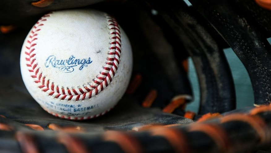 JUPITER, FL - MARCH 15: A detailed view of a Rawlings baseball sitting inside of a glove before the spring training game between the Miami Marlins and the New York Mets on March 15, 2016 in Jupiter, Florida. (Photo by Rob Foldy/Getty Images)
