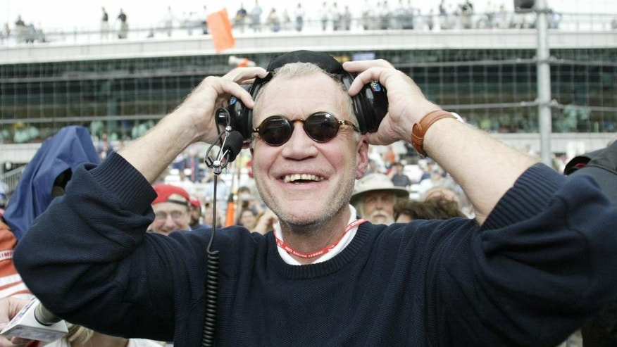 FILE - In this May 30, 2004, file photo, team co-owner David Letterman reacts as one of the team's drivers, Buddy Rice, wins the rain-shortened Indy 500 at Indianapolis Motor Speedway, in Indianapolis, Ind. (AP Photo/Tom Strattman, File)