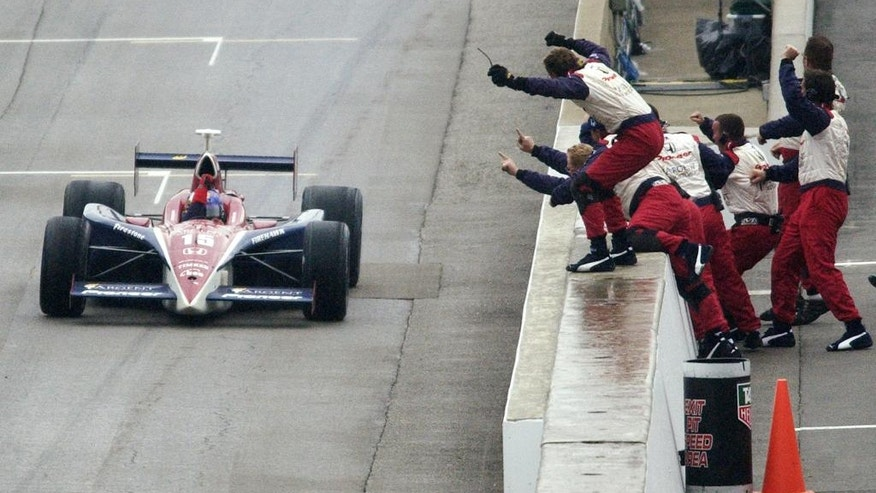 FILE - In this May 30, 2004, file photo, Buddy Rice's crew comes out to the pit wall to celebrate his Indy 500 win at Indianapolis Motor Speedway in Indianapolis, Ind. (AP Photo/Al Behrman, File)