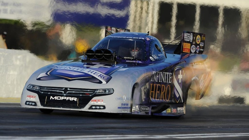 In this photo provided by NHRA, Jack Beckman drives his Funny Car to the qualifying lead at the Summit Racing Equipment NHRA Southern Nationals drag races, Friday, May 13, 2016, in Commerce, Ga. (Jerry Foss/NHRA via AP)