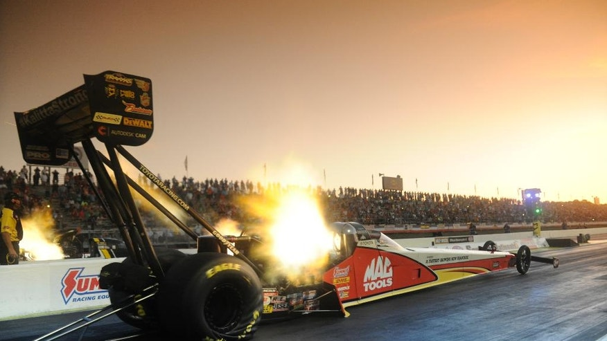 In this photo provided by NHRA, Doug Kalitta powers his Top Fuel car to the qualifying lead Friday, May 13, 2016, at the Summit Racing Equipment NHRA Southern Nationals drag races at Atlanta Dragway in Commerce, Ga. Kalitta posted a 3.731-second pass at 328.70 mph to take the qualifying lead. (Jerry Foss/NHRA via AP)