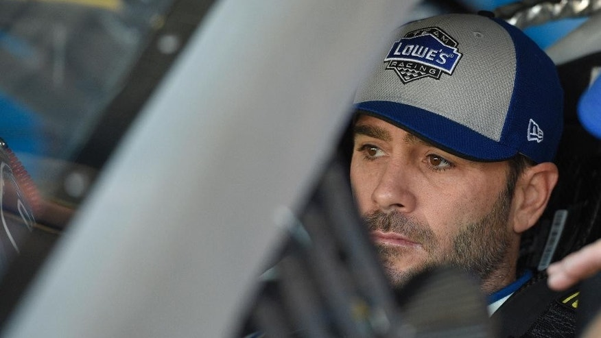Jimmie Johnson looks on in his car before practice for the NASCAR Sprint Cup series auto race, Saturday, May 14, 2016, at Dover International Speedway in Dover, Del. (AP Photo/Nick Wass)