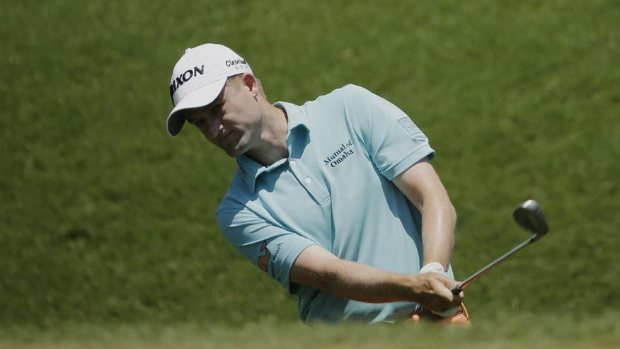 Russell Knox chips onto the second green during the third round of The Players Championship golf tournament Saturday, May 14, 2016, in Ponte Vedra Beach, Fla. (AP Photo/Chris O'Meara)