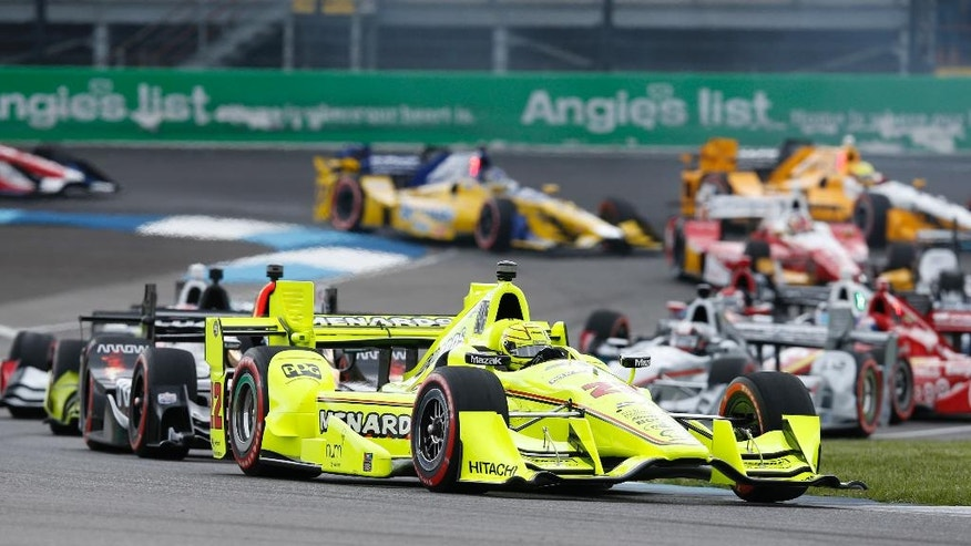 Simon Pagenaud, of France, leads the field through the second turn on the start of the Grand Prix of Indianapolis auto race at Indianapolis Motor Speedway in Indianapolis, Saturday, May 14, 2016. (AP Photo/Michael Conroy)