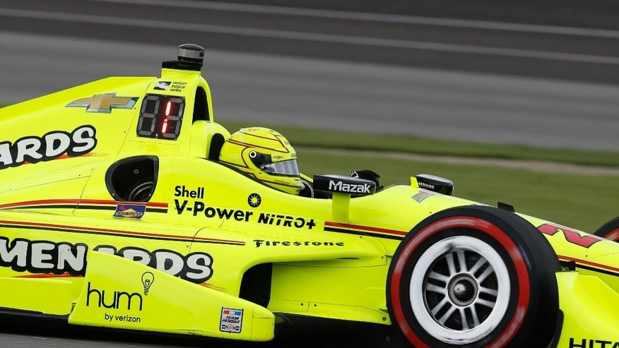 Simon Pagenaud, of France, drives through a turn during the Grand Prix of Indianapolis auto race at Indianapolis Motor Speedway in Indianapolis, Saturday, May 14, 2016. (AP Photo/Michael Conroy)