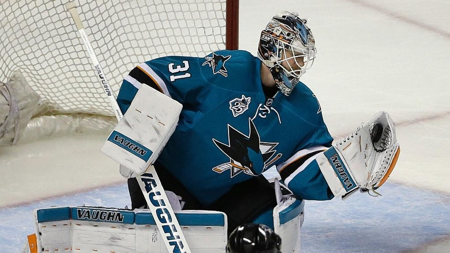 San Jose Sharks goalie Martin Jones makes a save on a shot from the Nashville Predators during the first period of Game 7 of an NHL hockey Stanley Cup Western Conference semifinal playoff series Thursday, May 12, 2016, in San Jose, Calif. The Sharks won 5-0 and advanced to the conference finals. (AP Photo/Ben Margot)