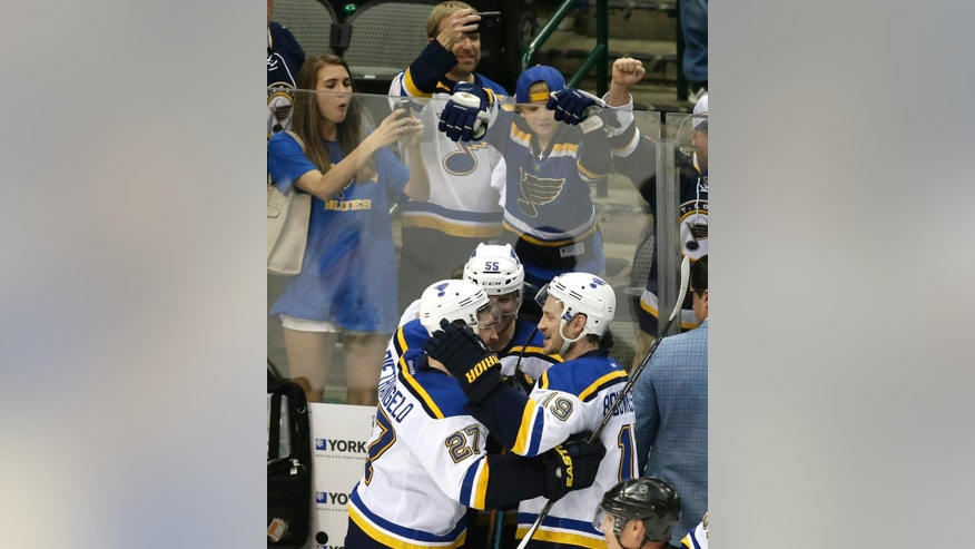 St. Louis Blues Alex Pietrangelo (27), Colton Parayko (55) and Jay Bouwmeester (19) celebrate after Game 7 of the NHL hockey Stanley Cup Western Conference semifinals against the Dallas Stars on Wednesday, May 11, 2016, in Dallas. The Blues won 6-1. (AP Photo/LM Otero)