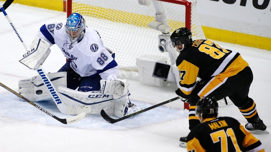 Tampa Bay Lightning goalie Andrei Vasilevskiy (88) stops a shot by Pittsburgh Penguins' Sidney Crosby (87) during the third period of Game 1 of the NHL hockey Stanley Cup Eastern Conference finals Friday, May 13, 2016, in Pittsburgh. The Lightning won 3-1. (AP Photo/Gene J. Puskar)