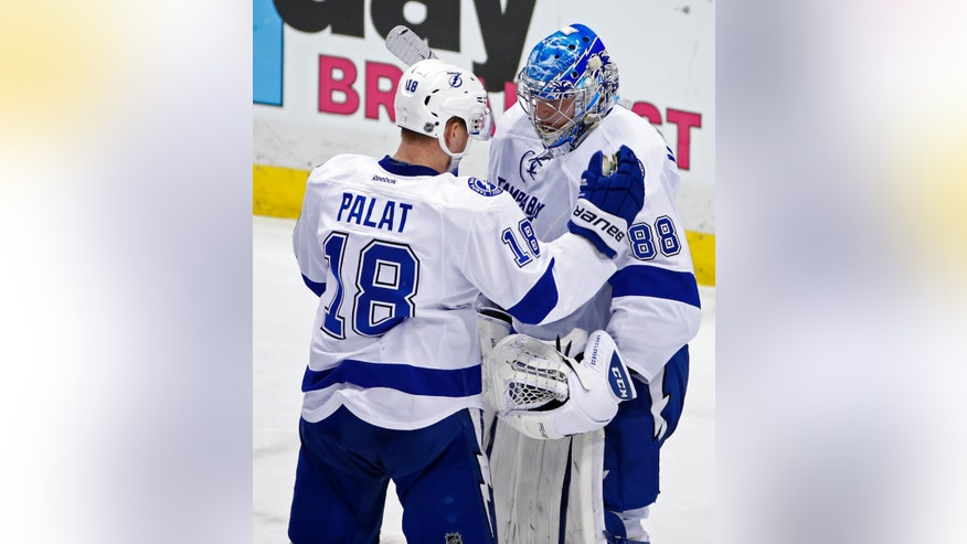 Tampa Bay Lightning goalie Andrei Vasilevskiy (88) celebrates with Ondrej Palat (18) after the Lightning's 3-1 win over the Pittsburgh Penguins in Game 1 of the NHL hockey Stanley Cup Eastern Conference finals Friday, May 13, 2016, in Pittsburgh. (AP Photo/Gene J. Puskar)