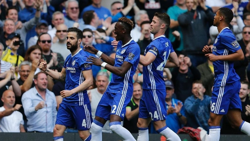 Chelsea's Cesc Fabregas, left, celebrates with teammates after scoring during the English Premier League soccer match between Chelsea and Leicester City at Stamford Bridge stadium in London, Sunday, May 15, 2016.(AP Photo/Frank Augstein)