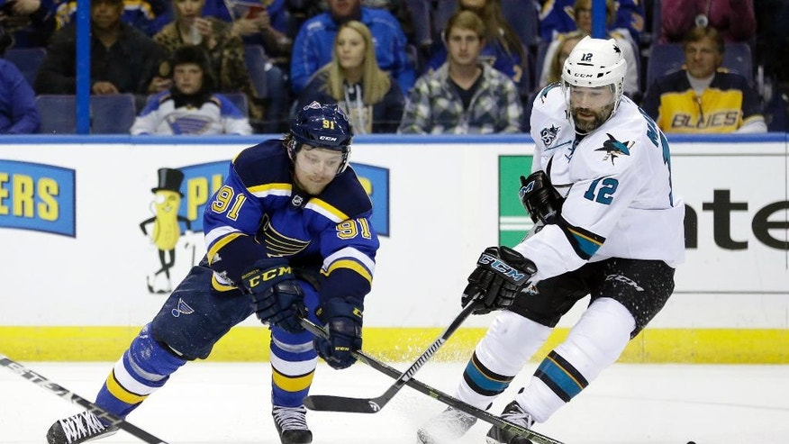 St. Louis Blues right wing Vladimir Tarasenko (91) chases the puck against San Jose Sharks center Patrick Marleau (12) during the second period in Game 1 of the NHL hockey Stanley Cup Western Conference finals, Sunday, May 15, 2016, in St. Louis. (AP Photo/Jeff Roberson)