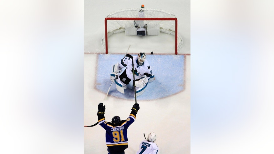 San Jose Sharks goalie Martin Jones (31) gives up a goal by St. Louis Blues center Jori Lehtera as the Blues right wing Vladimir Tarasenko (91) celebrates during the second period in Game 1 of the NHL hockey Stanley Cup Western Conference finals, Sunday, May 15, 2016, in St. Louis. (AP Photo/Jeff Roberson)