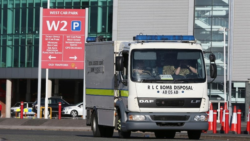 Police bomb squad unit leaves Old Trafford stadium after today's final soccer match of the season between Manchester United and AFC Bournemouth was abandoned due to a suspect package being found inside the stadium. Sunday May 15, 2016. (Martin Rickett/PA via AP) UNITED KINGDOM OUT - NO SALES - NO ARCHIVES